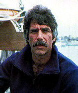 Sam Elliott as Travis McGee